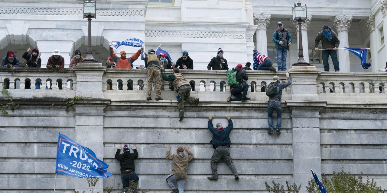 Rioters Climbing Capitol Hill Wall